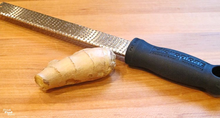 Grating fresh ginger to use in this Asian Sesame Ginger Vinaigrette is simple to do when you use the right tool, like this Microplane shredder. It's super sharp and makes grating anything that's more firm much easier.