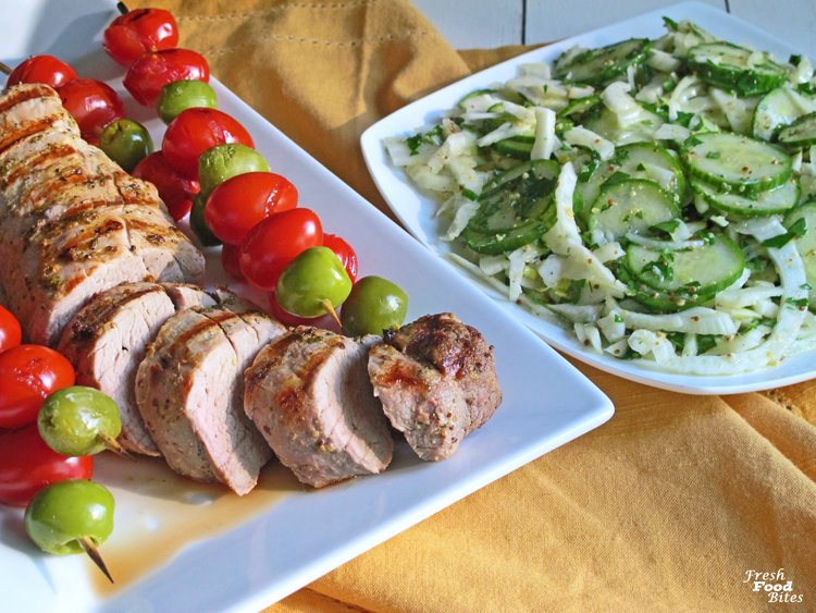 This easy, healthy Grilled Pork Tenderloin with Marinated Cucumber-Fennel Salad is the perfect gluten free, dairy free grilled dinner for summer. Use half of the vinegar and mustard based marinade for the pork tenderloin and half as a vinaigrette for the vegetable salad, making this recipe quick to make. There are just a few ingredients, a lot of flavor and no added sugar, making this tasty recipe something you will feel great eating!