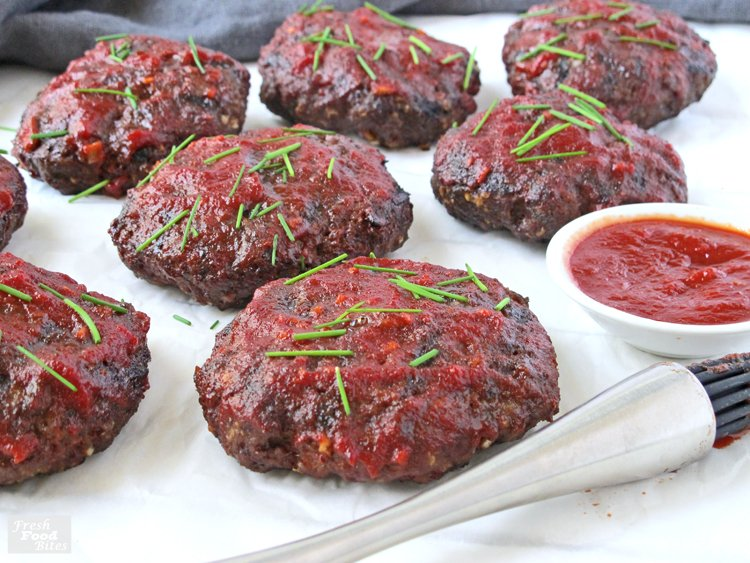 "These healthy, gluten free Grilled Mini Meat Loaves are the answer to your ""quick dinners for busy weeknight meals"" prayers. The meat loaves only have 5 simple ingredients and the sauce takes all of 5 minutes to stir together. They are grilled rather than baked, so you can keep the heat and mess out of your kitchen. This easy recipe is one you will want to make again and again!"